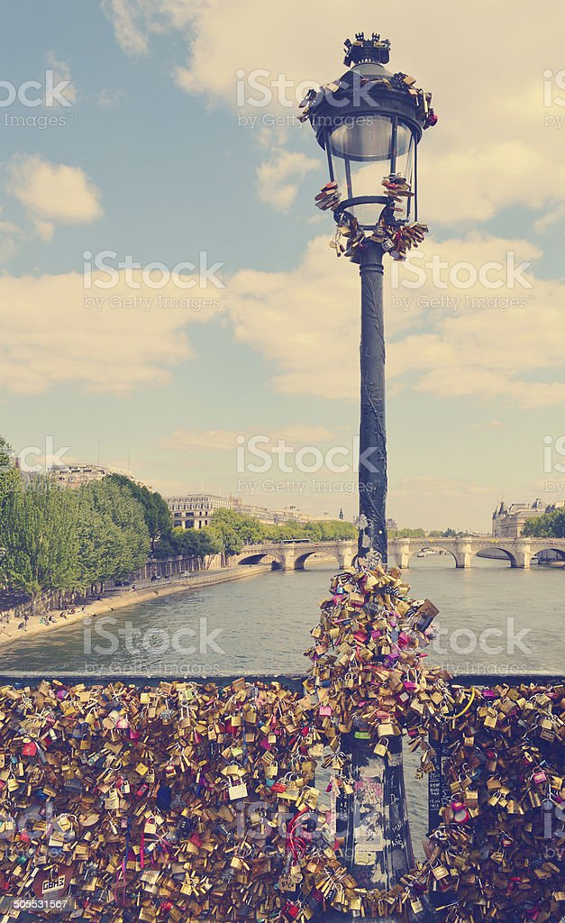 The romantically love inscribed padlocks on Pont Des Arts Bridge stock photo