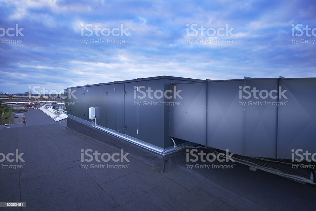The roof of an industrial building with air conditioning equipment stock photo