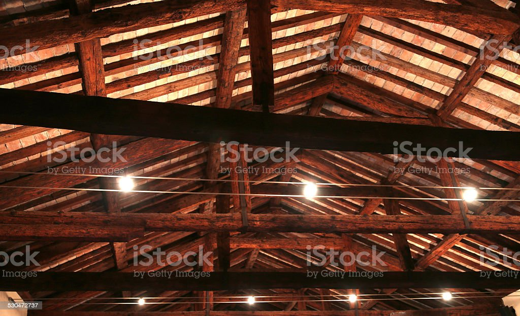 the roof with beams facing bricks and halogen lamps stock photo
