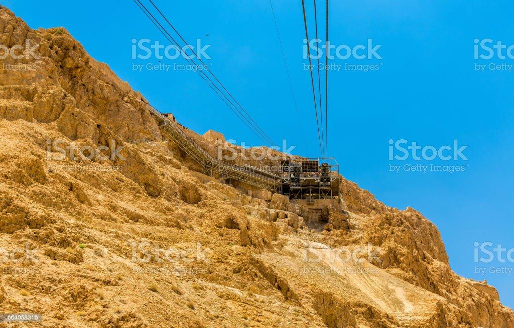 The ropeway to Masada fortress - Israel stock photo