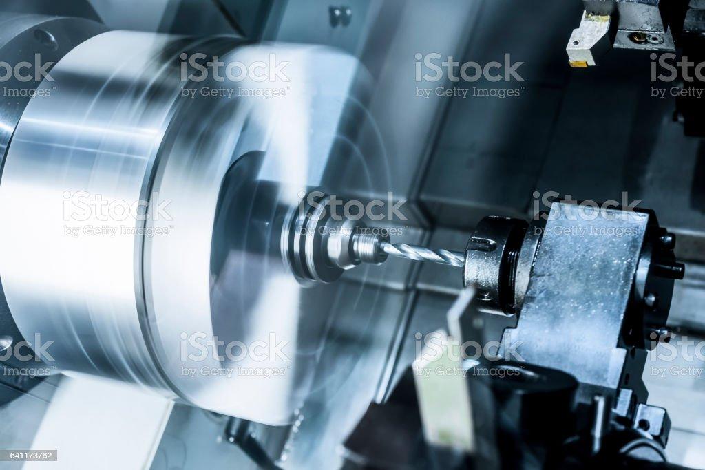 The rotating lathe spindle. stock photo