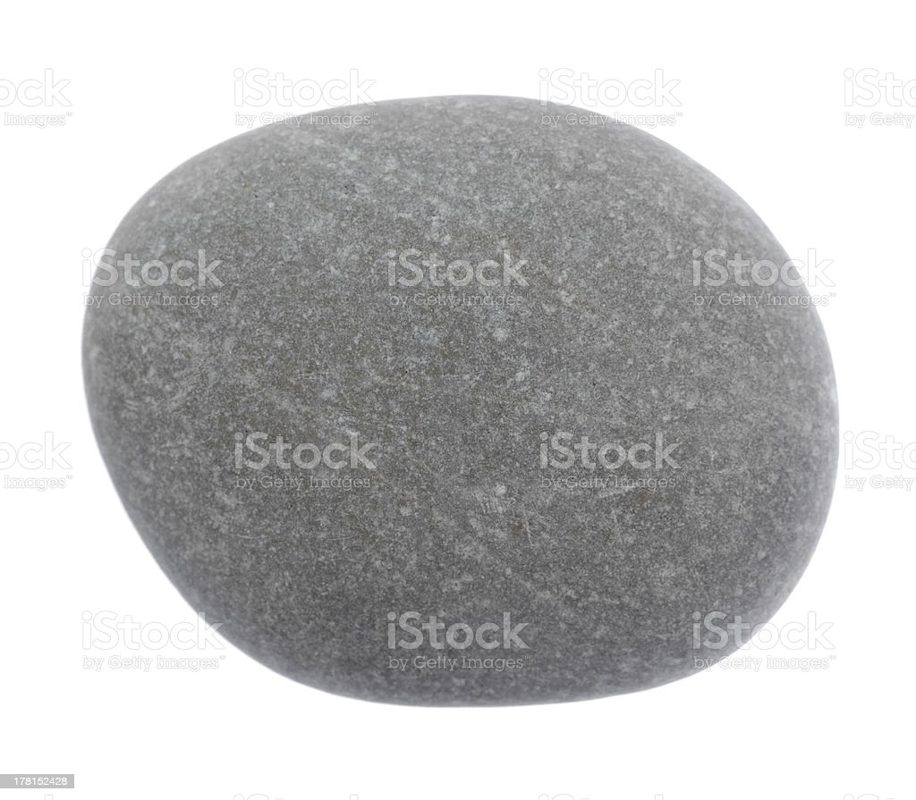 The round stone is isolated on a white background royalty-free stock photo