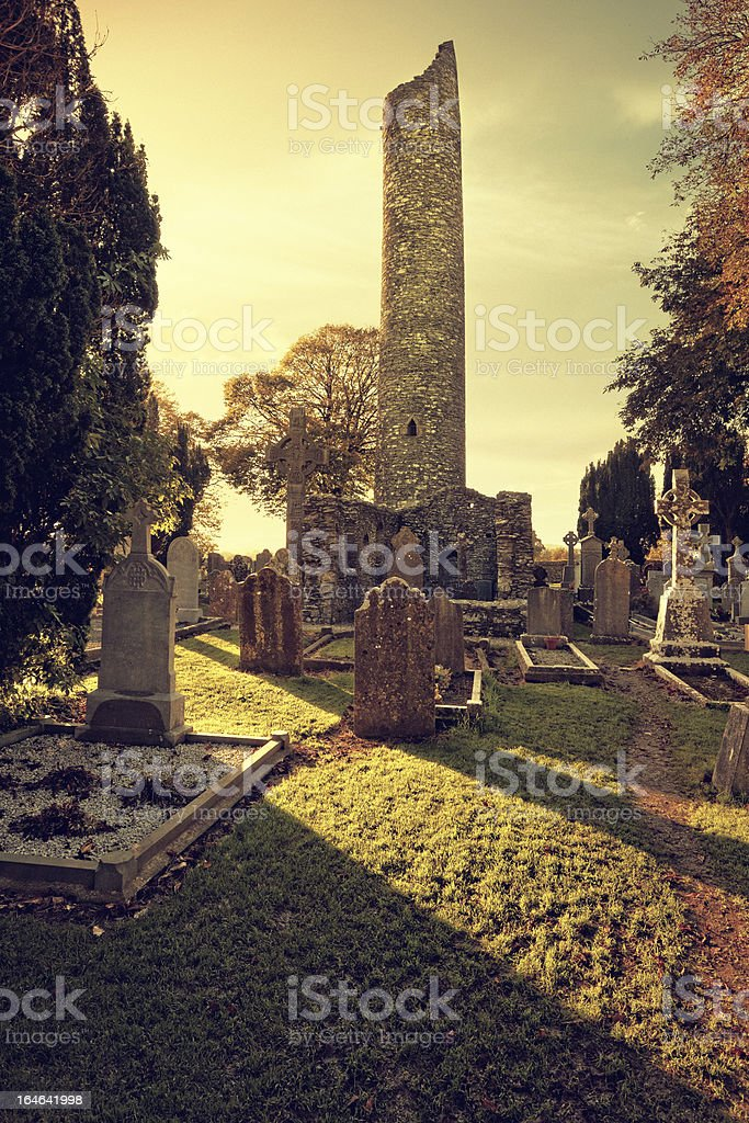 The round tower of Monasterboice at sunset royalty-free stock photo