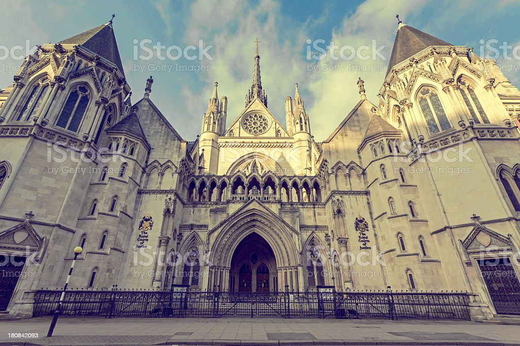 The Royal Courts of Justice with blue sky and clouds royalty-free stock photo