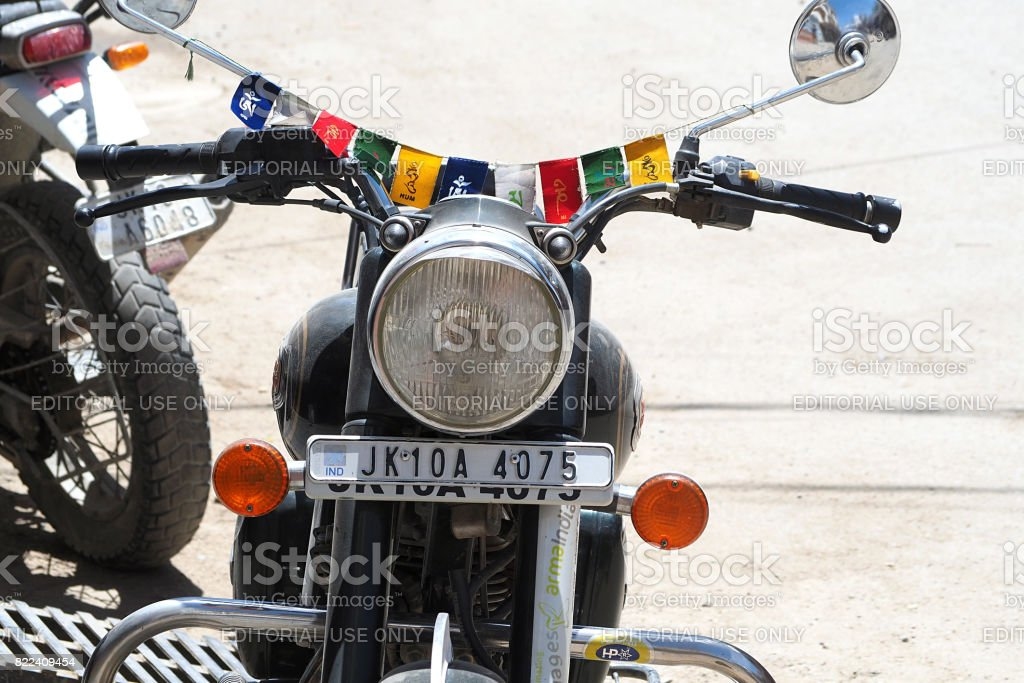 the Royal Enfield motorcycle with buddha mantra flag the famous  motorbike riding in Leh Ladakh, India. stock photo