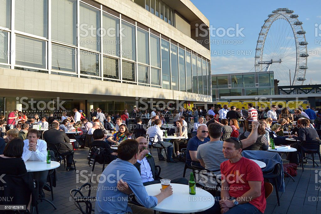 The Royal Festival Hall in with London Eye stock photo