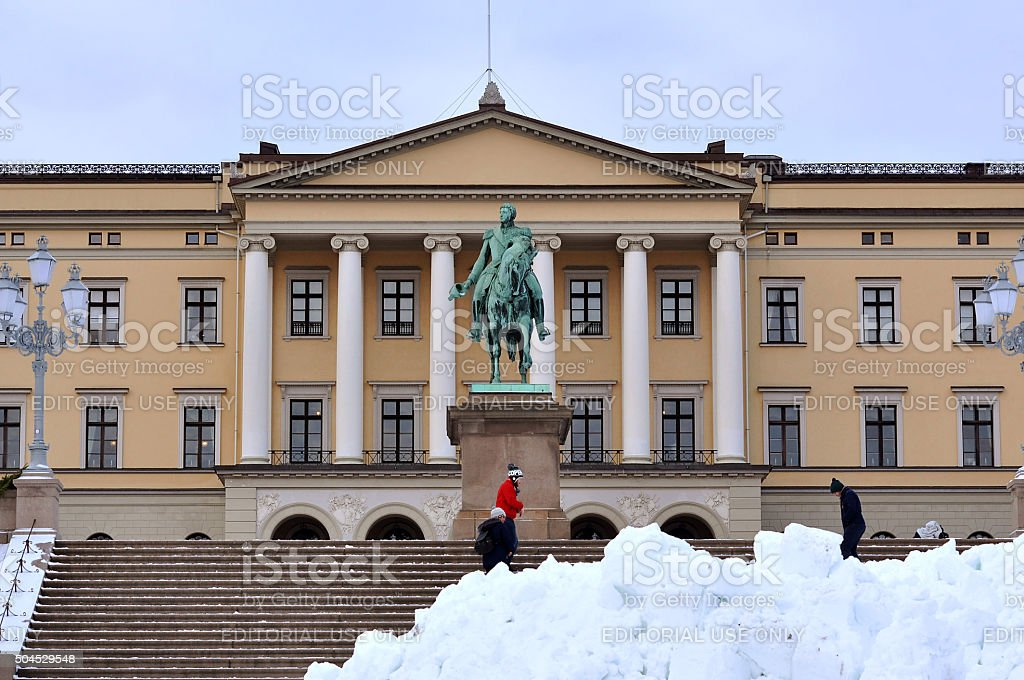 The Royal Palace and some tourists in Oslo stock photo