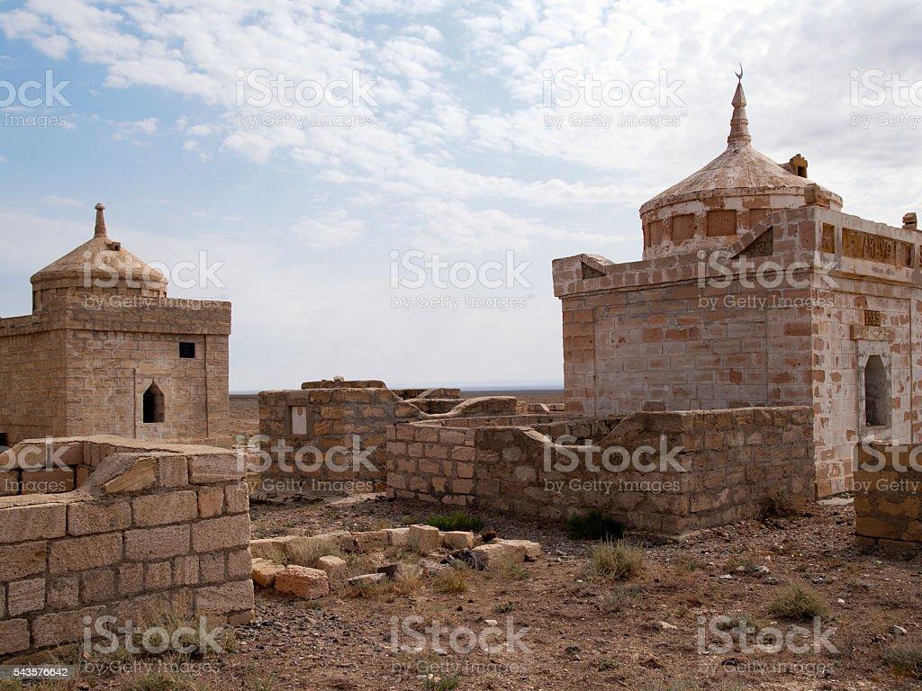 The ruins mausoleum of an ancient Muslim cemetery, Ustyurt, Kazakhstan stock photo