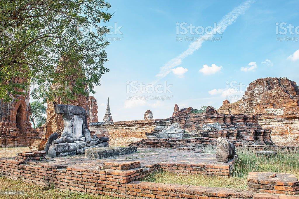The ruins of ancient Image of Buddha at Wat Mahathat stock photo