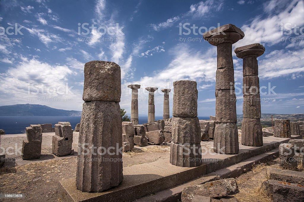 The ruins of Assos against the cloudy sky stock photo