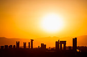 The ruins of the acient city Persepolis at sunset, Iran