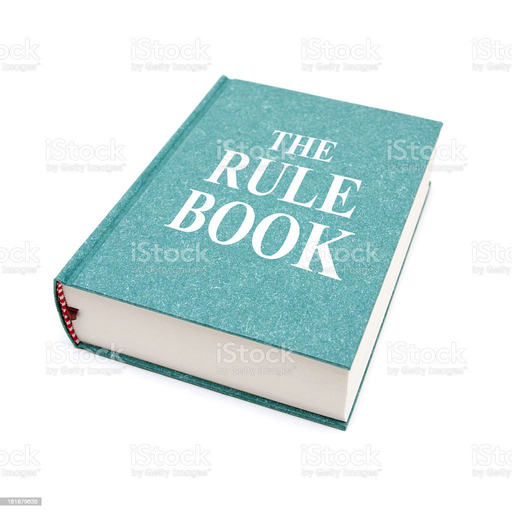 The Rule Book isolated on white background stock photo