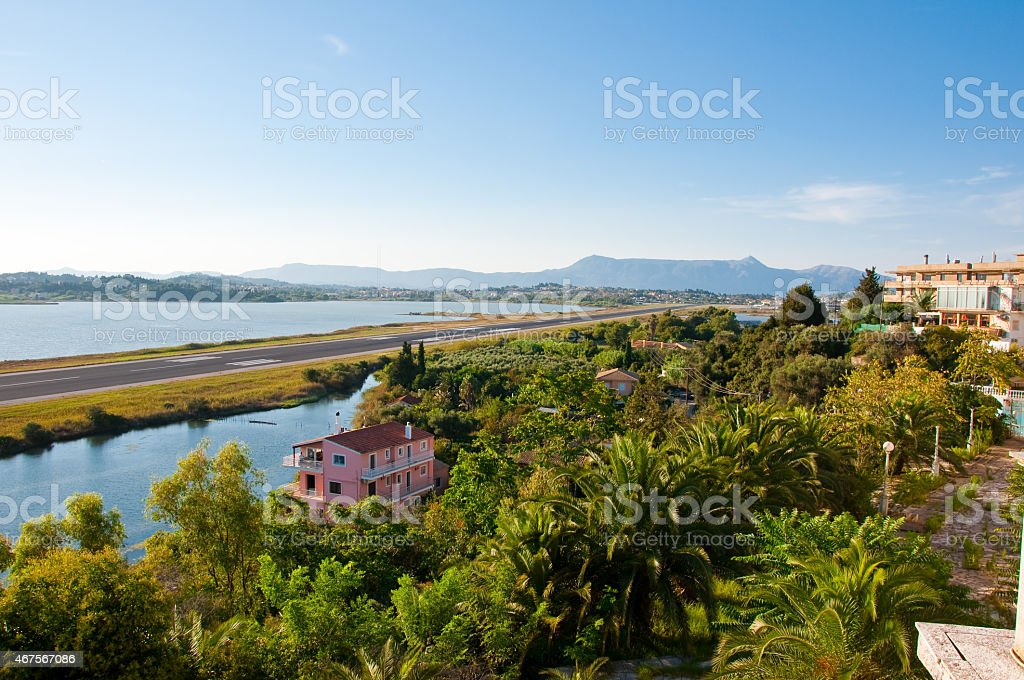The runway across the Chalikiopoulou Lagoon from Kanoni hilltop.Corfu, Greece. stock photo