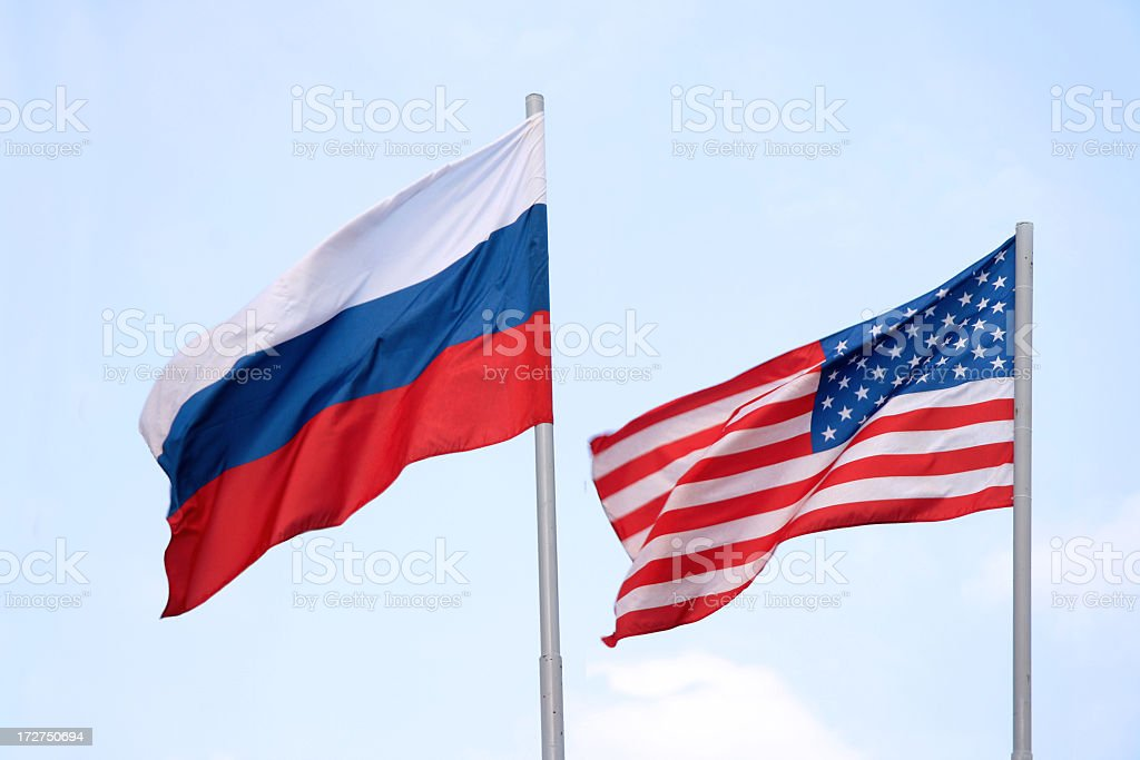 The Russian and American flags flying side by side stock photo