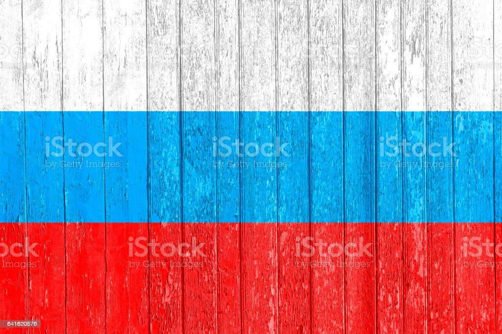 The Russian flag painted on a wooden fence. Political concept. Old texture. stock photo