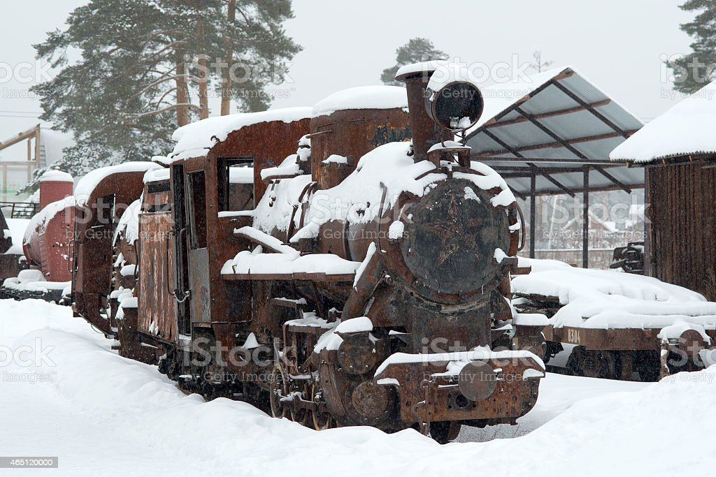 the rusted engine in the winter in the afternoon stock photo