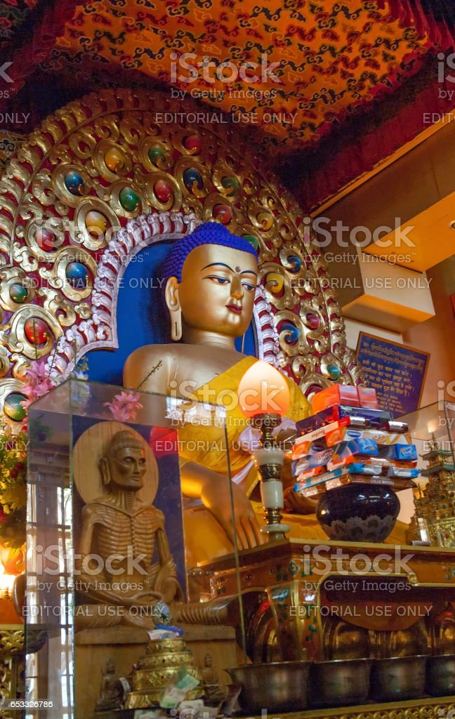 The sacred Buddha statue and gold jewelry Buddhist monastery  Residence of His Holiness the Dalai Lama XIV. stock photo