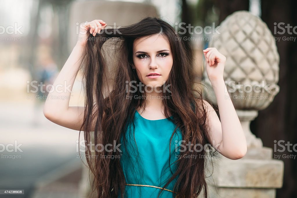 the sad girl with long hair and a creative make-up stock photo