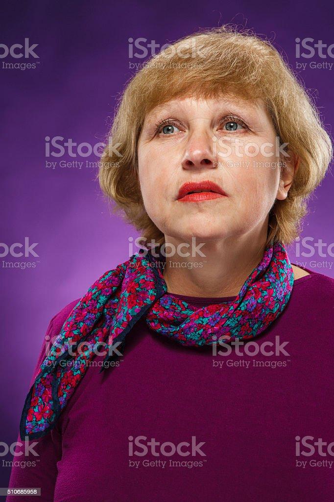 The sad senior woman stock photo