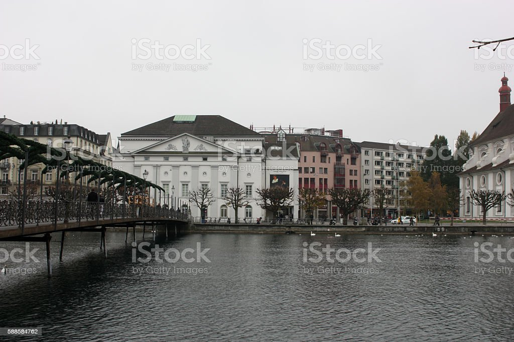 The sad view of the house, standing along the lake stock photo