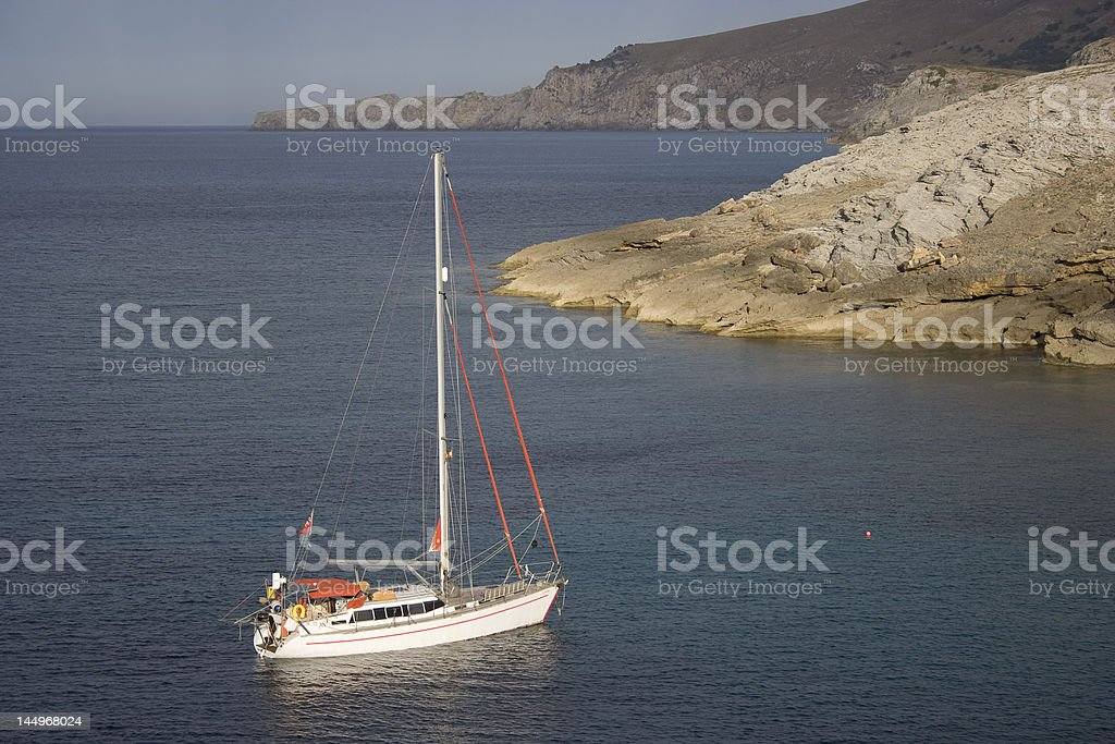 The sailboat in a calm bay. royalty-free stock photo
