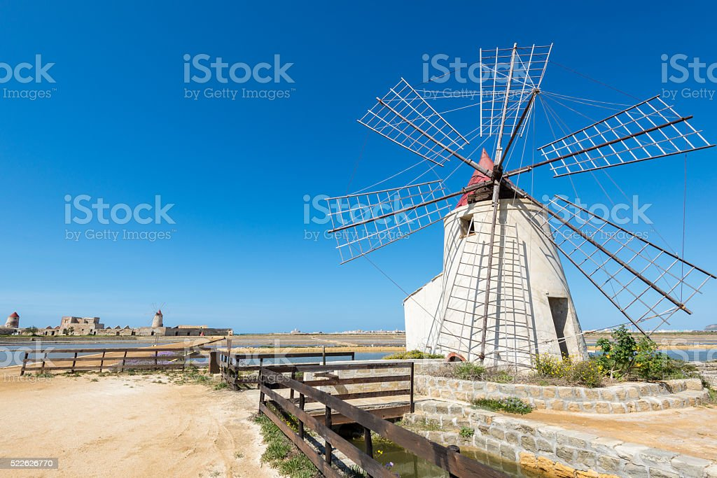 The salt flats with windmills of Trapani, Sicily (Italy) stock photo
