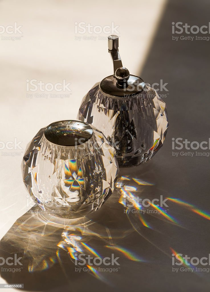 The saltcellar and a pepper-pot produce the caustics stock photo