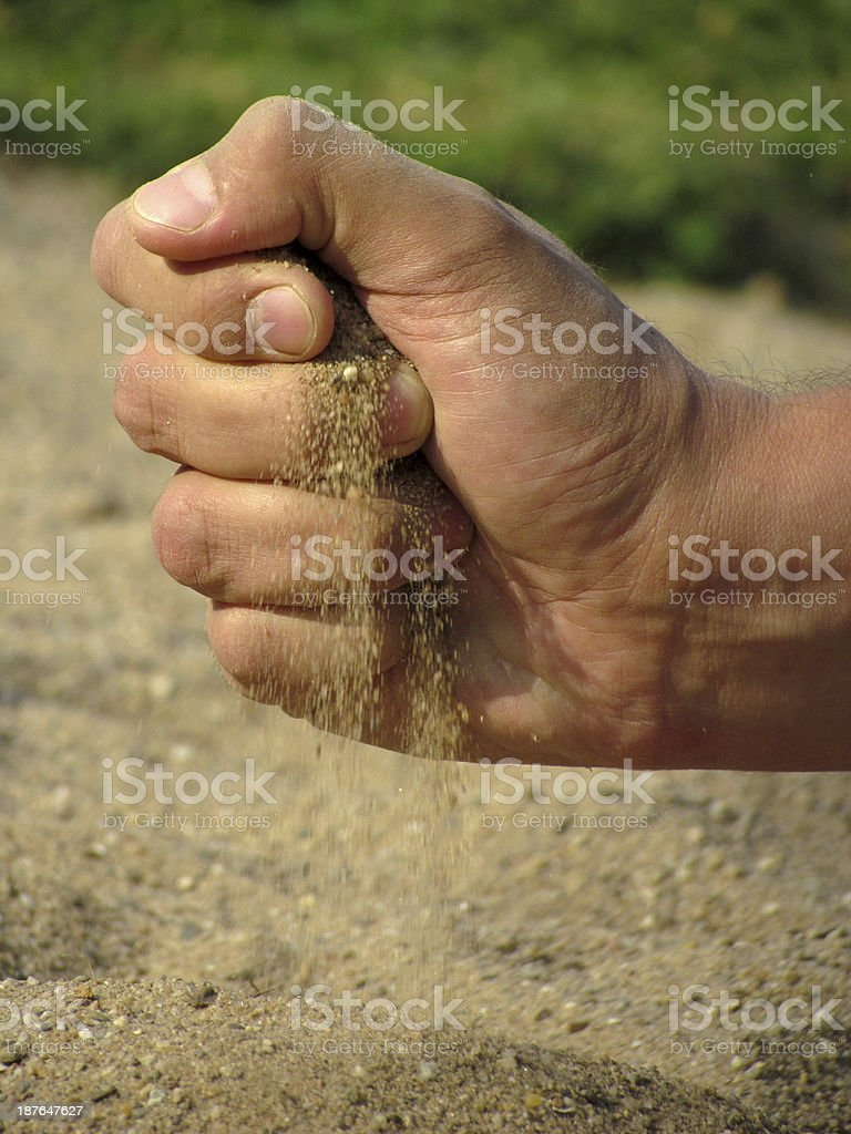 The sand trickled through my fingers stock photo