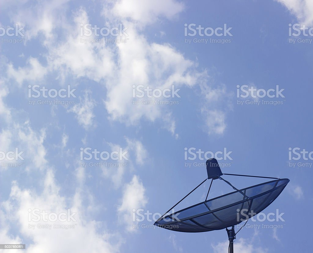 The satellite dish with the blue sky background royalty-free stock photo