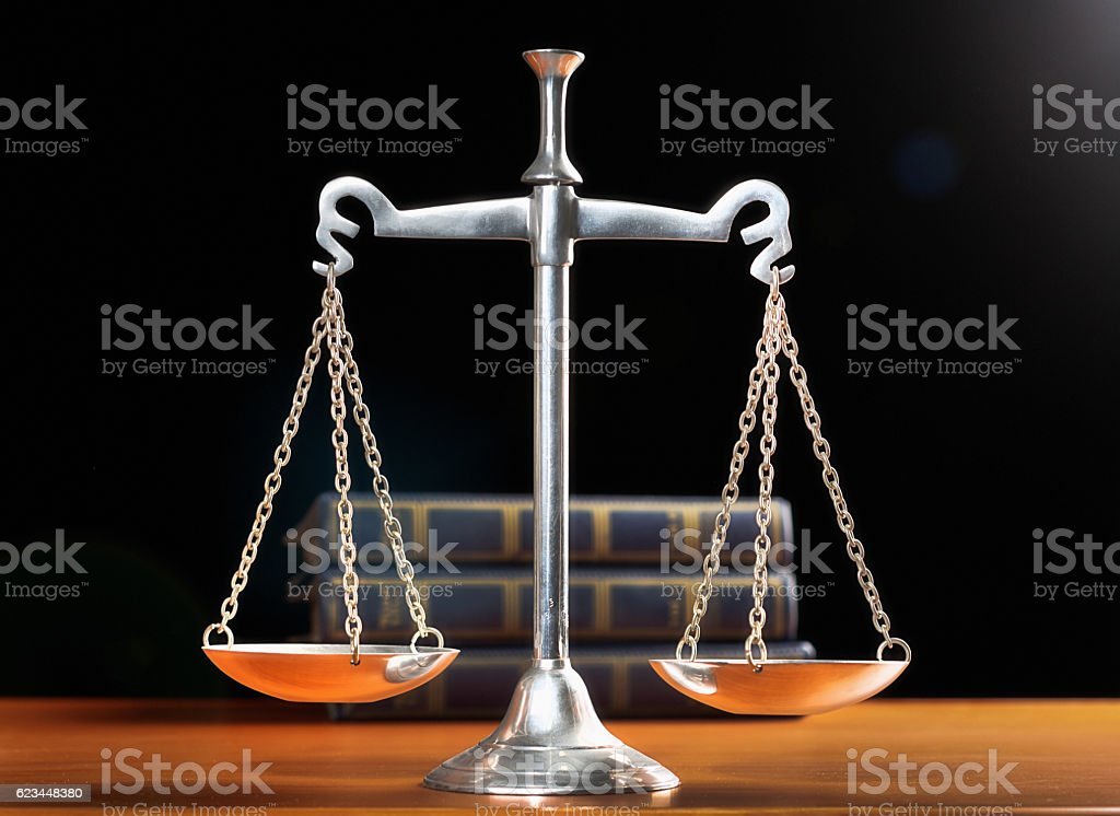 The Scales of Justice, backed by law books stock photo