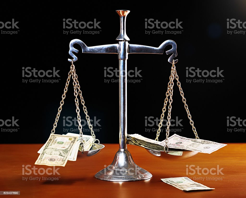 The Scales of Justice corrupted by money stock photo