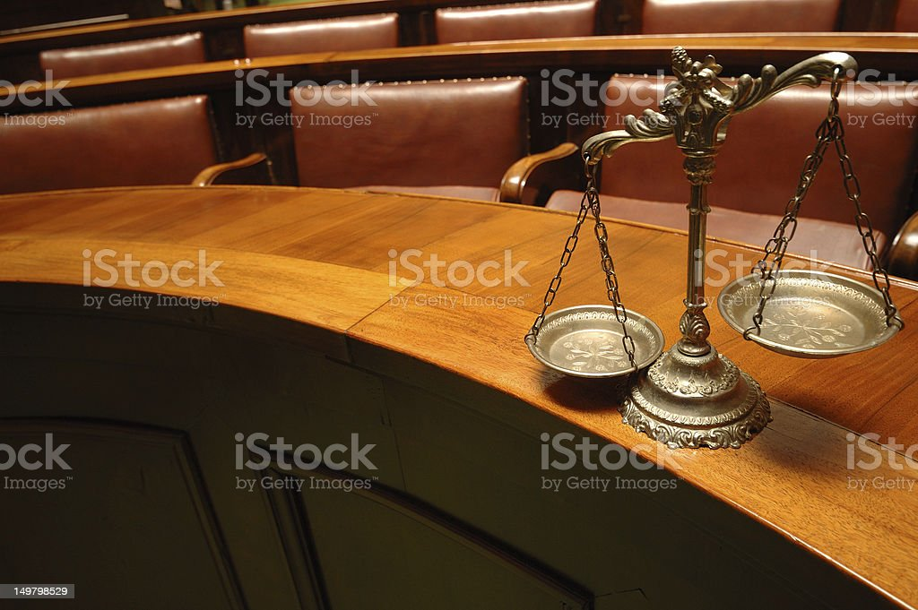 The scales of justice in a courtroom royalty-free stock photo
