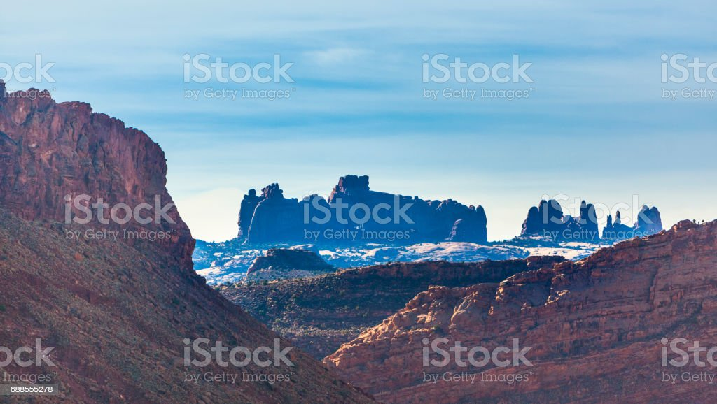 The scenic view to remote mountains in Arches national park, Utah. stock photo