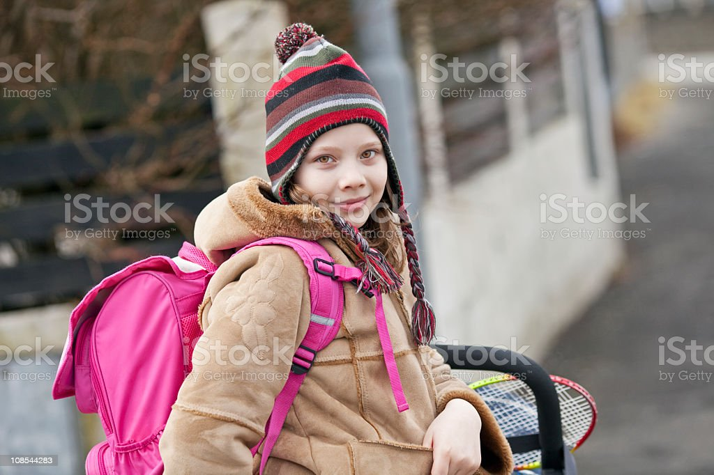 The schoolgirl with a backpack royalty-free stock photo