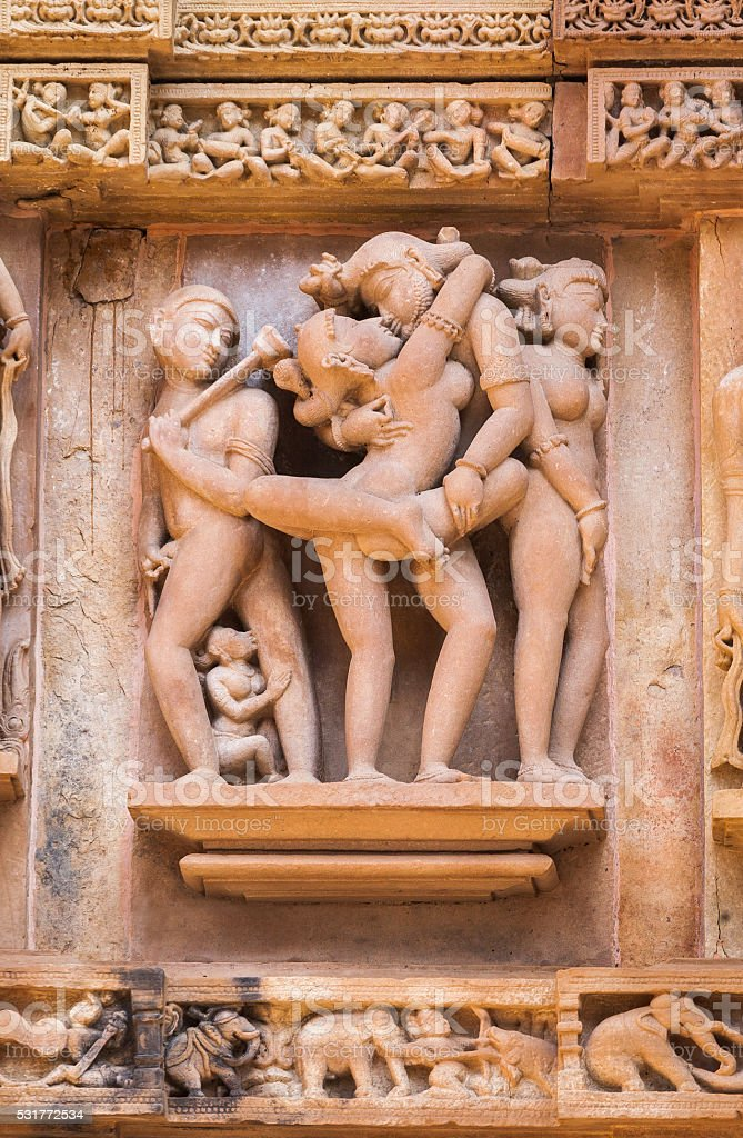 The sculptures being couple in one of Kama-Sutra poses. stock photo