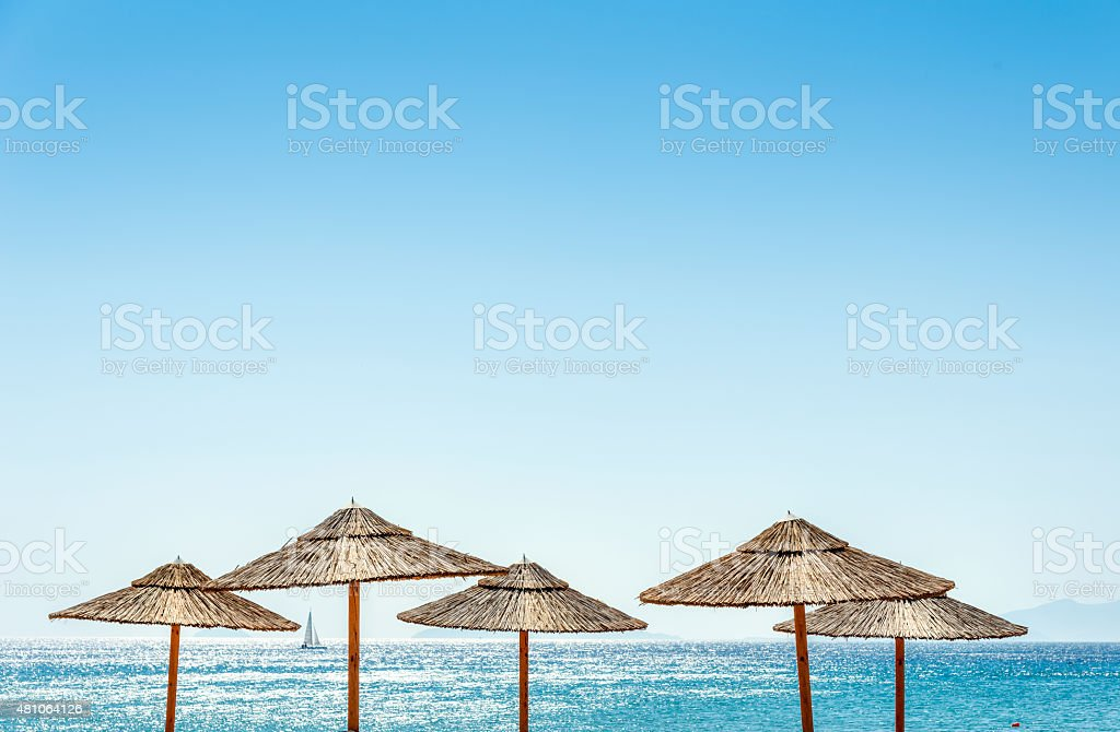 The sea and parasols at the Beach stock photo