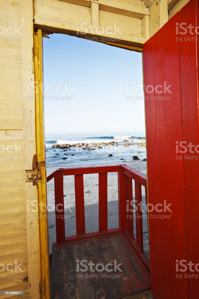 The sea seen from inside rustic beach hut royalty-free stock photo