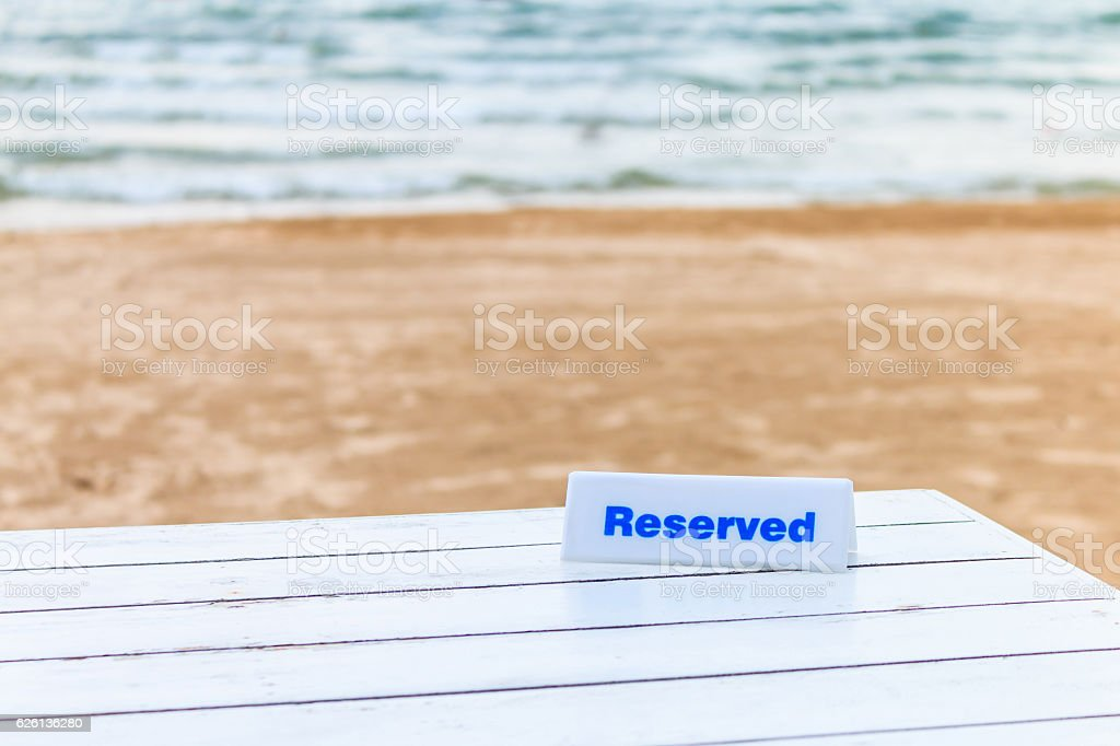 The seaside table with beach and sea background has reserved stock photo