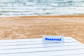 The seaside table with beach and sea background has reserved