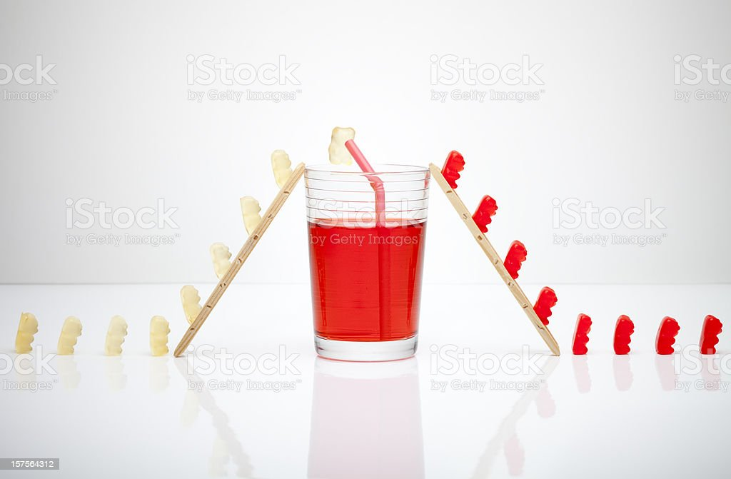 The secret about red gumibears. Gummy Bear drinking Art Humor stock photo