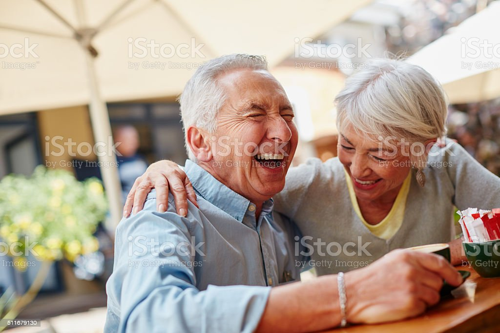 Shot of a senior couple having coffee at a...