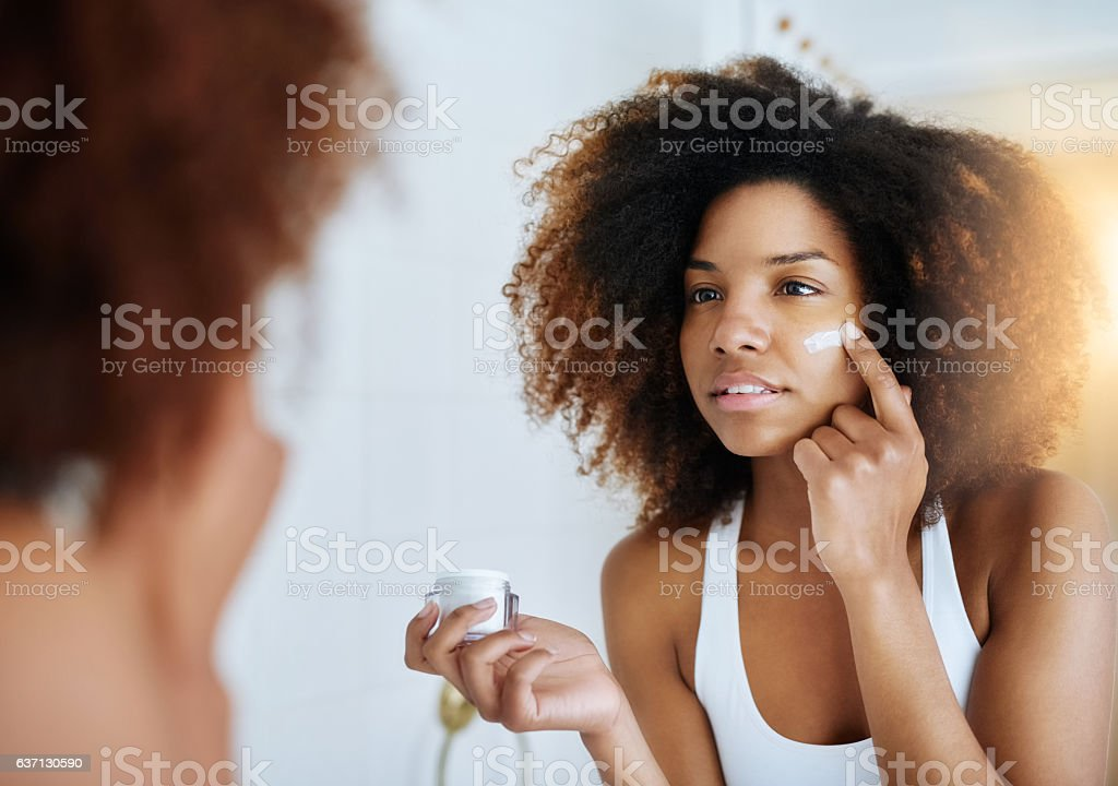 The secret to her flawless skin stock photo