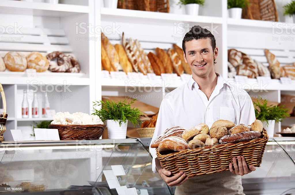 The seller in shop stock photo