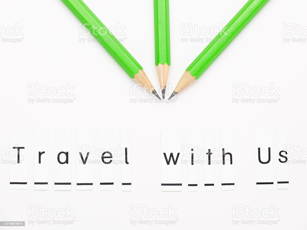 The sentence 'Travel with Us'  with green pencils on white. stock photo