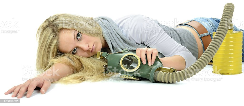The serious girl with gas mask. royalty-free stock photo