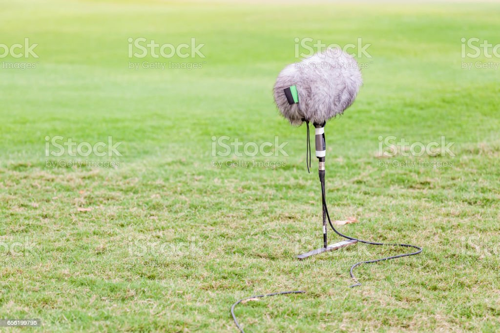 The set of large microphone boom with windshield for live sport broadcasting. stock photo