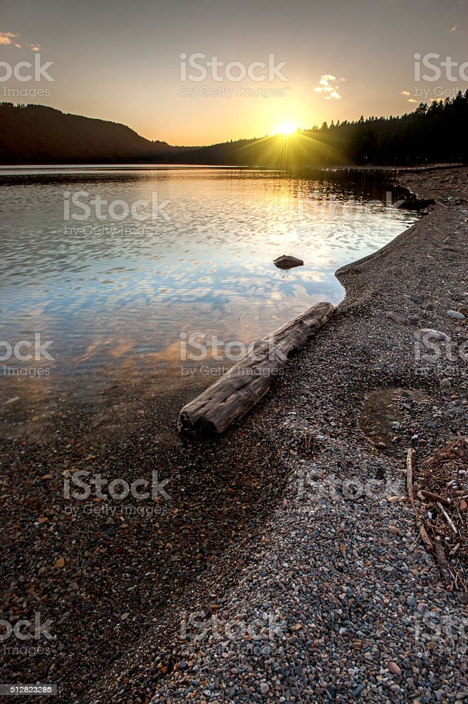 The setting sun over Pend Oreille lake. stock photo