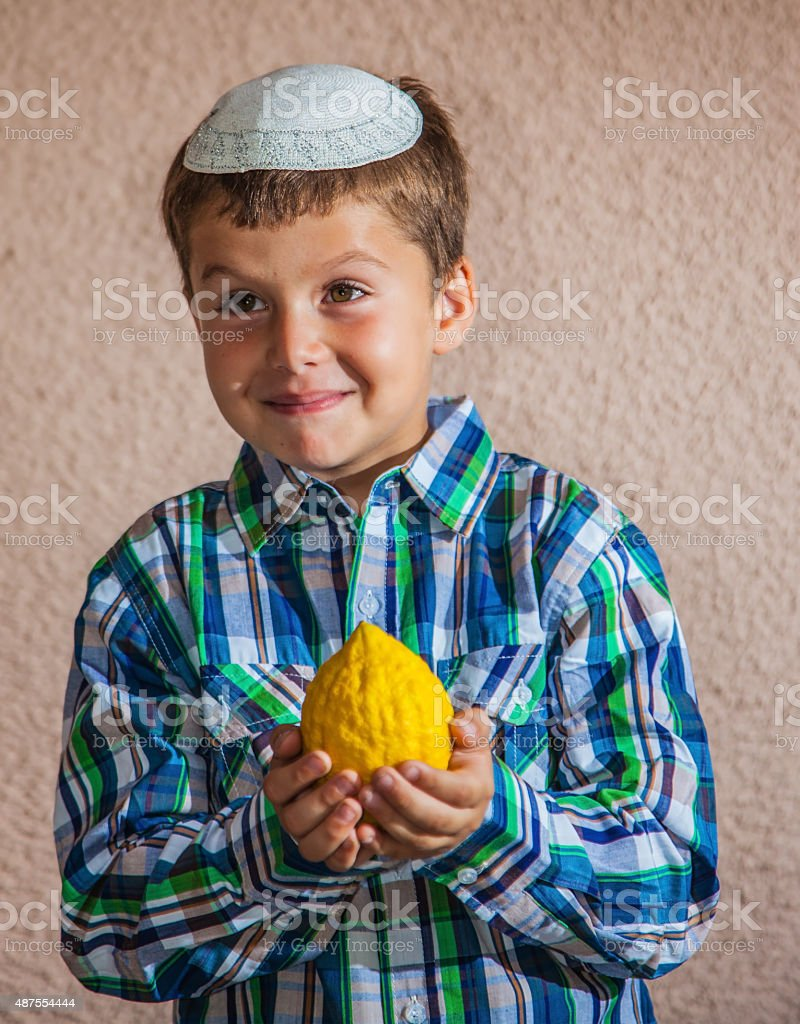 The seven year old boy is holding citron stock photo