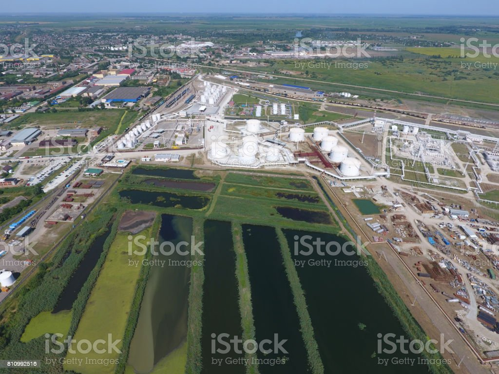 The sewage treatment plant in Slavyansk-on Kuban. Water for sewage treatment in a small city. Bright reeds on the banks of water stock photo
