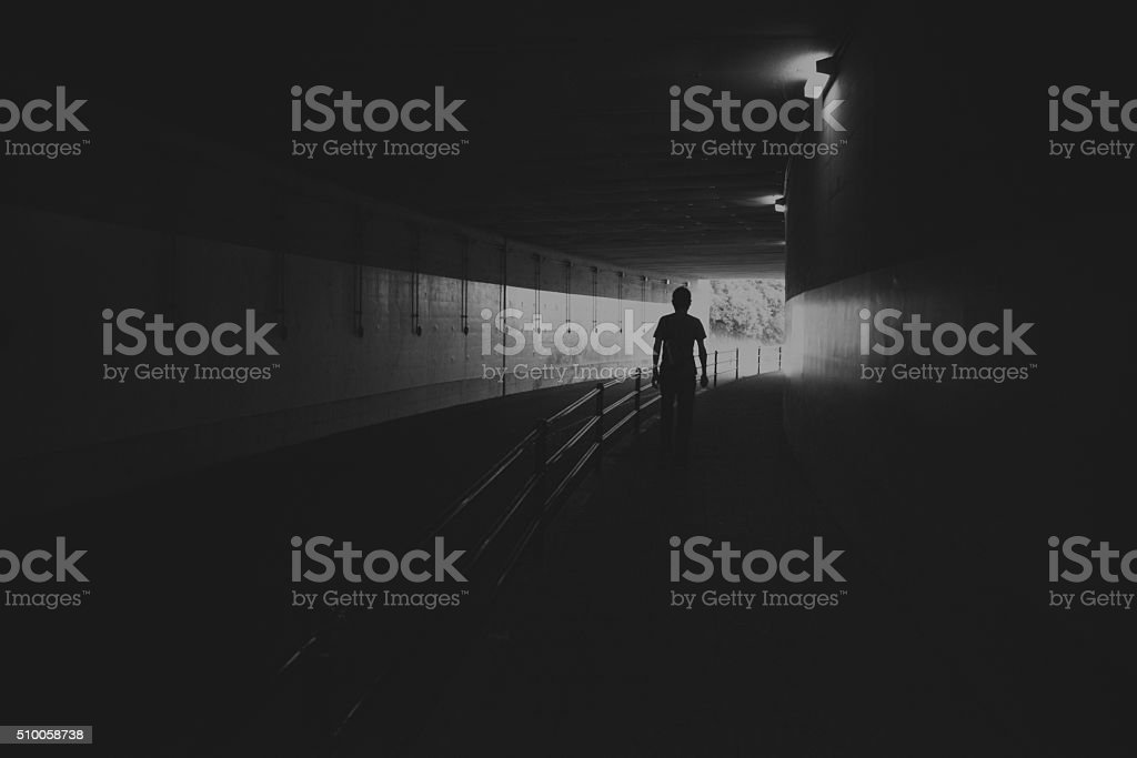 The shadow of the men who walk the dark tunnel stock photo